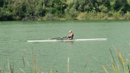 Man kayaking, rowing in river, slow motion shot at 120fps