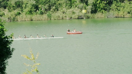 A group of men kayaking, rowing in river, slow motion