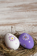 Colorful Easter Eggs on old white wooden board