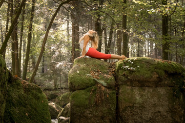 Yoga on a rock in a forrest