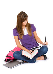 Student: Adult Student Taking Notes From Book