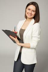 Businesswoman in white jacket write on clipboard