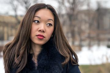 portrait of a beautiful Asian girl looking sideways