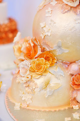 Fancy delicious white and yellow wedding cake