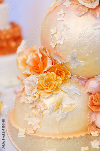 Fancy delicious white and yellow wedding cake - 78504611