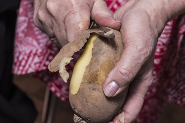 Peeling potatoes