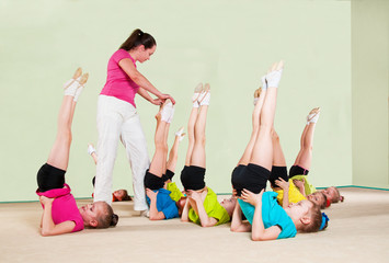 Group of children engaged in physical training in gym