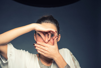 Young brunette woman holding her nose because of a bad smell
