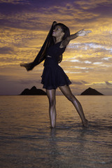 black dancer on the beach at dawn