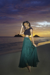 black girl in dress on the beach at dawn
