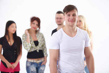 young blonde on the background of the group are the students