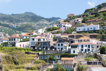 Little village build against a mountain slope at Madeira Island