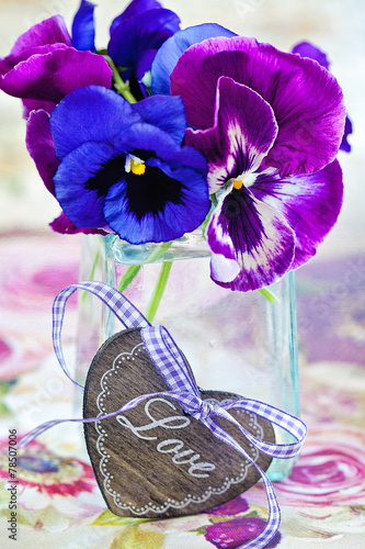 Canvas Pansies Photo of a beautiful purple pansy flowers and wooden heart.