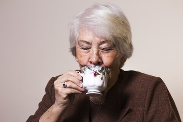 Elderly woman with a cup of tea