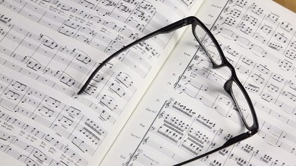 Sheet music with glasses