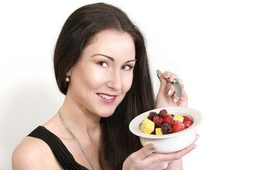 Smiling woman with fruits and berries, healthy diet