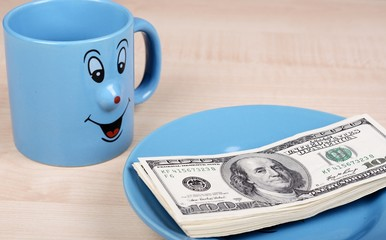 Cup and dollar. The cup is looking for dollars