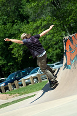 Skateboarder Riding Skate Ramp