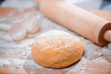 Cooking in the kitchen with rolling pin