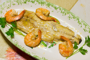 Tasty fish dish with shrimp
