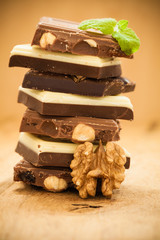 Stack of different sorts chocolate and walnut
