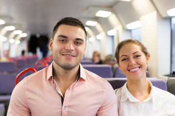 Young couple sitting in modern train