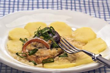 Swiss fish rolls in white wine sauce