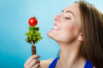 Portrait of smiling woman holding healthy food.