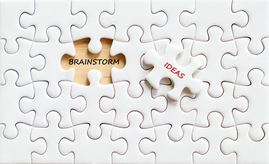 Brainstorm and ideas words on jigsaw puzzle background, business