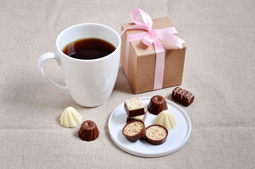 Chocolates a a cup of coffee