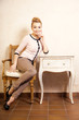 Vintage style. Girl sitting at the retro desk.