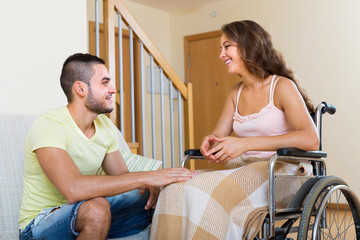 man and girl in wheelchair having conversation