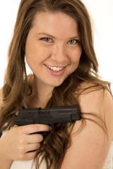 Woman with a black pistol devious smile