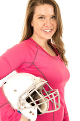 Young brunette female model holding American football helmet