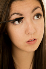 Asian American beauty teen gilr applying her mascara