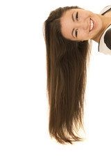 Fun Asian American teen laying down hair flowing