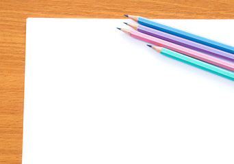 Blank note paper and pencil background