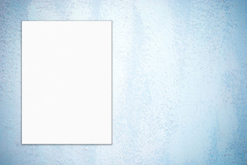 Blank white poster on blue cement wall background, template