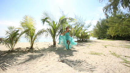 asian girl's gorgeous blue dress blows under wind near small pal
