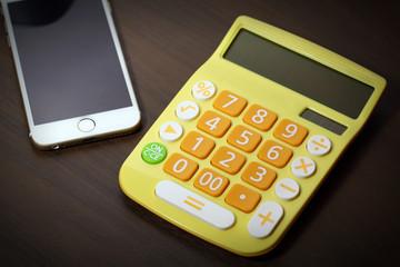 calculator, smartphone on table