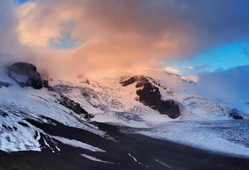 High mountain peak during sunrise. Beautiful natural landscape