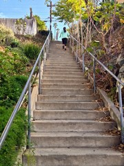 Young Woman Running on Urban City Stairs, La Mesa, California