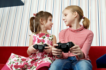 Girls playing on games console