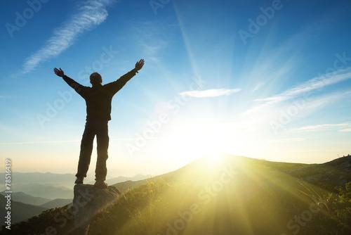 Leinwandbild Motiv Winner on mountain top. Sport and active life concept..