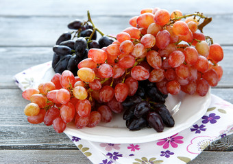 Fresh grapes on a white plate