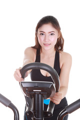 young woman doing exercises with exercise machine