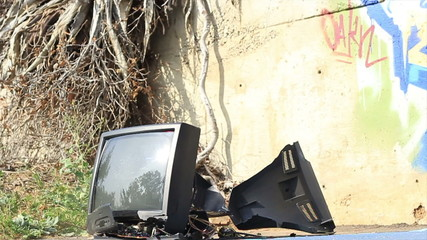 Old TV set shatters on the ground