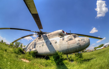 The russian heavy transport helicopter Mi-6 at an abandoned aero