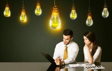 Business couple with idea bulbs