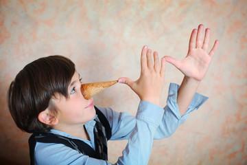 creative preteen handsome boy have an idea about pinoccio image